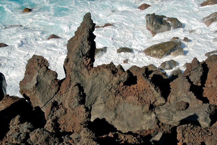 Aquatic Sport Beach Beauty In Nature Day Eroded Geology High Angle View Land Nature No People Outdoors Rock Rock - Object Rock Formation Rough Sea Solid Tranquility Volcano Water