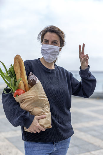 Portrait of woman carrying food