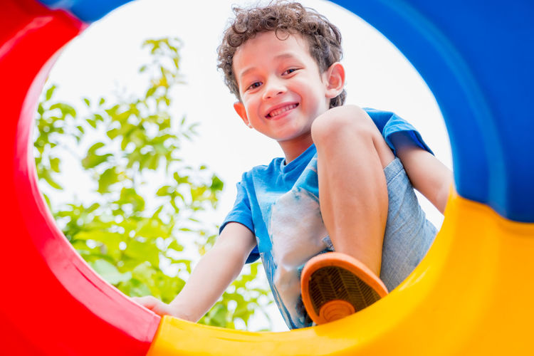 Cute boy playing in playground