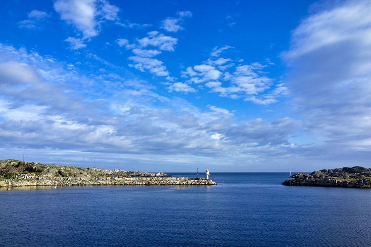 Norway, Utsira, Sørdvik: port entrance Horizontal Day Outdoors Port Entrance Cloud - Sky Sky Water Sea Scenics - Nature Blue Beauty In Nature Tranquility Tranquil Scene Waterfront No People Nature Horizon Over Water Idyllic Horizon Non-urban Scene Built Structure Nautical Vessel Sailboat