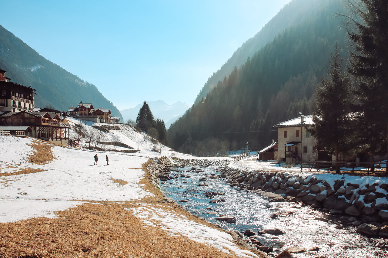 mountain, snow, architecture, winter, built structure, building exterior, cold temperature, sky, nature, scenics - nature, tree, beauty in nature, day, building, mountain range, land, no people, house, water, outdoors, snowcapped mountain