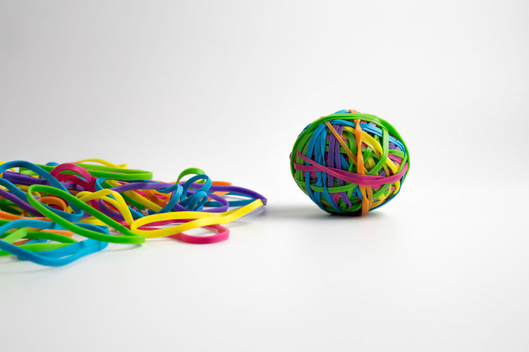 Close-up of multi colored balls against white background