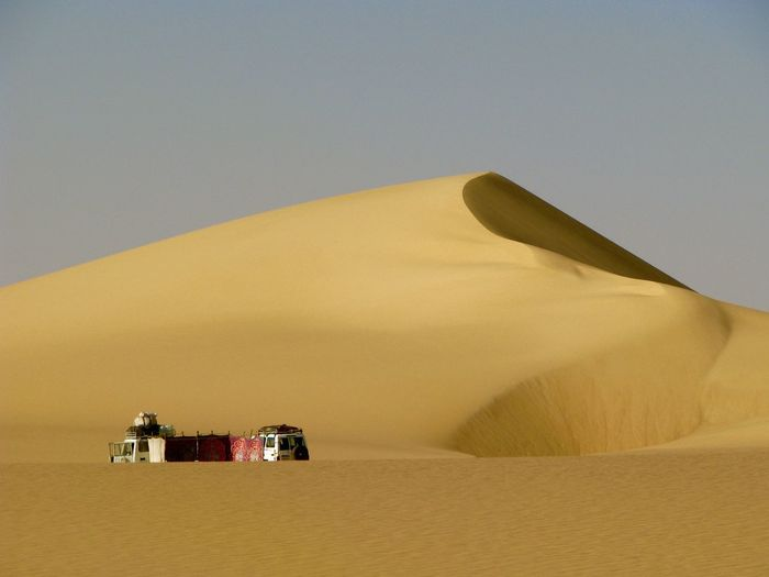 EyeEmNewHere Arid Climate Beauty In Nature Car Clear Sky Day Desert Land Vehicle Landscape Nature No People Off-road Vehicle Outdoors Sand Sand Dune Scenics Sky Transportation