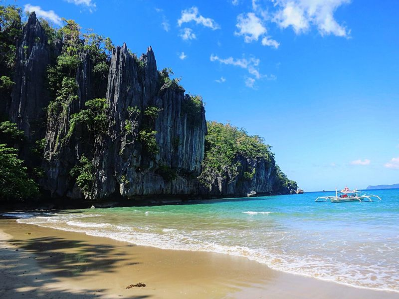 Sea Scenics Blue Beach Water Beauty In Nature Nature Tranquil Scene Tranquility Idyllic Tree Sky Tropical Climate Travel Destinations Outdoors No People Vacations Horizon Over Water Day Eye Em Philippines EyeEm Nature Lover Underground River