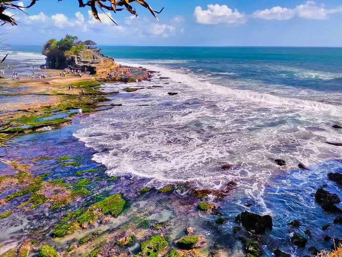 High angle view of tanah lot by sea against sky