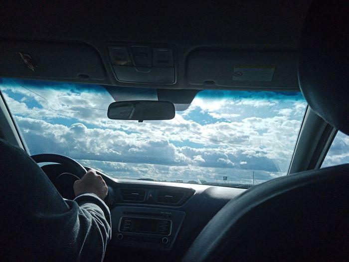 Tilt image of person seen through car windshield
