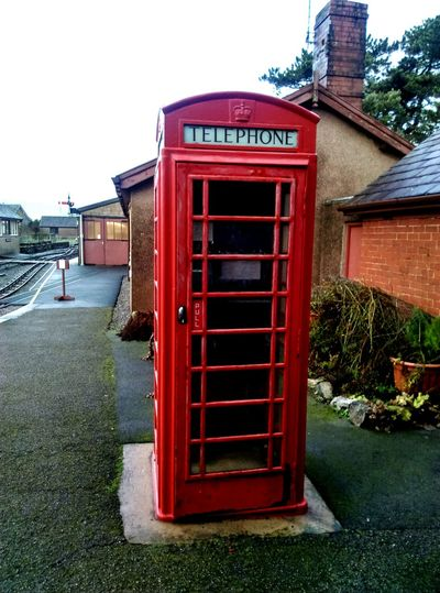 red telephone box Telephone Booth Clear Sky No People Building Exterior Pay Phone Built Structure Architecture Red Communication Day Outdoors Connection Grass Sky Text