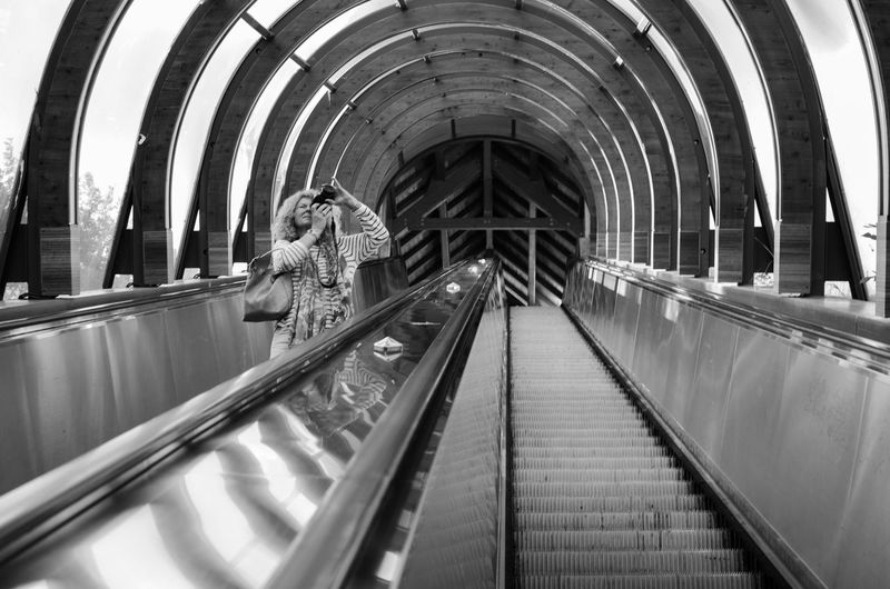 Arch Architectural Column Architecture Blackandwhite Built Structure Day Diminishing Perspective Escalator Escalators Lifestyles Metallic Modern Photographer Photographing Reflection The Way Forward Travel Destinations Vanishing Point Woman Embrace Urban Life