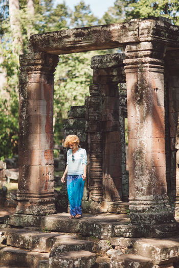 Full Length Of Young Woman At Angkor Wat