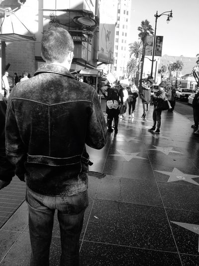 Rear View Street Real People Men Road City Outdoors Architecture Day One Person Adult People Stars & Dreams Hollywood Stars Tourist Attraction  Street Photography Streetphoto_bw Man Leather Jacket Looking Ahead California Tourism Tourists Destination Scenics