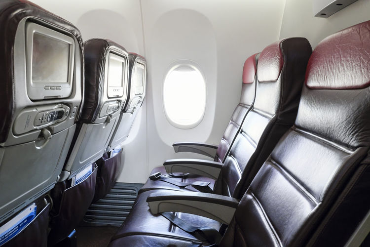 Inflight economy class cabin seats of an airplane. Boeing 737-800 Horizontal Composition Aircraft Airplane Airplane Seat Cabin Day Empty Flying In A Row Inflight Interior No People Seat Transportation Travel Window