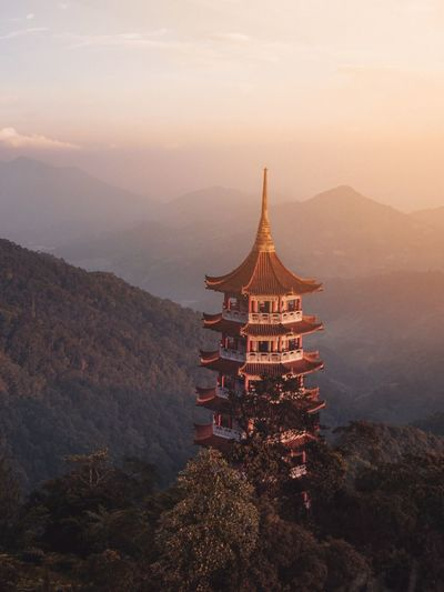 High angle view of traditional building on mountain during sunset