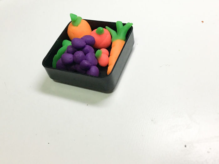 High angle view of multi colored candies on table