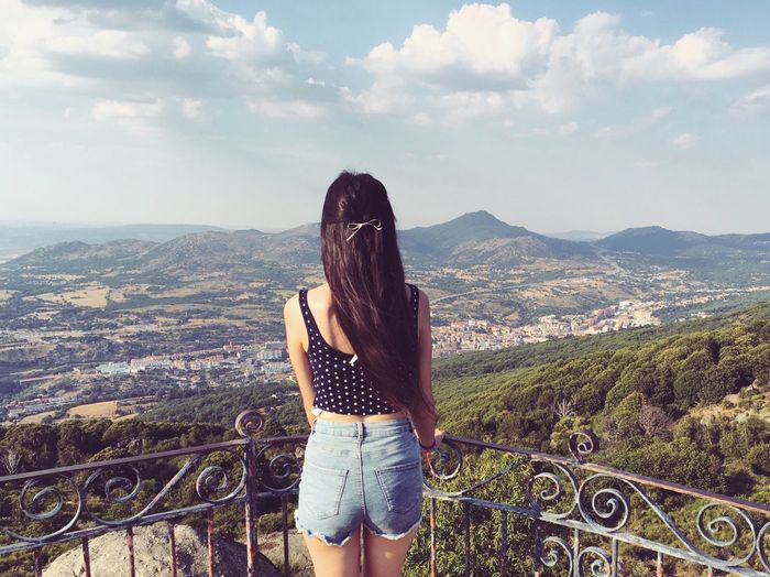 Rear view of young woman standing at observation point