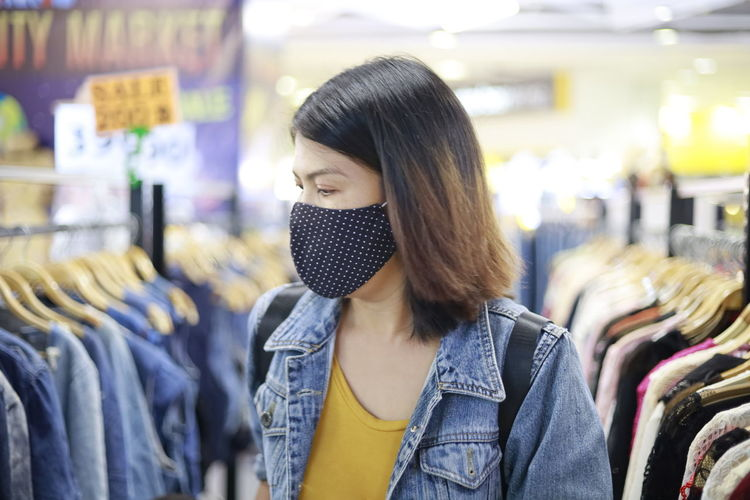 Young woman standing at store