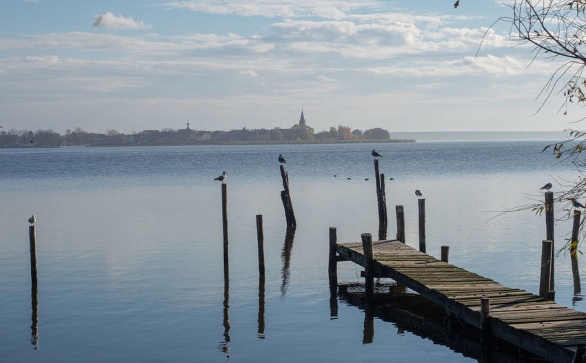 Pier in Altwarp Water Wood - Material Sky Tranquility Nature Tranquil Scene Architecture Built Structure No People Post Wooden Post Beauty In Nature Scenics - Nature Day Pier Sea Transportation Outdoors Non-urban Scene Ueckermünde