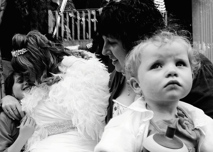 After the wedding friends and family enjoy unwinding Celebration Wedding Friends Friendship Weddings Wedding Photos Guests Black And White Black & White Monochrome Portraits Portrait Women Child Monochrome Portrait Eye4photography  EyeEm Best Shots Wedding Guests Wedding Photography People Watching Weddings Around The World People Peoplephotography Wedding Day Bride
