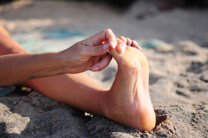 Low section of person legs on beach