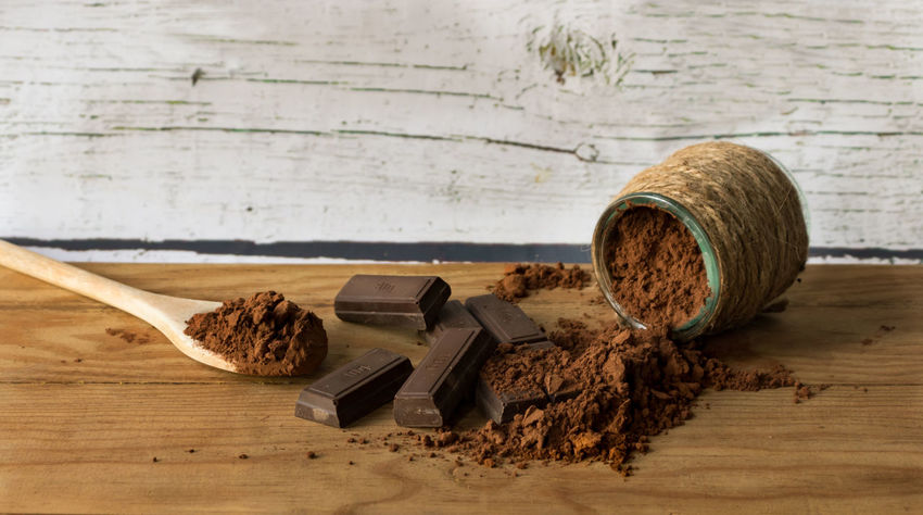 Ounces of chocolate and pure cocoa powder Chocolate Additive Brown Cacao Chocolat Addictive Close-up Container Dirt Focus On Foreground Food Food And Drink Freshness Healthy Eating Indoors  Ingredient Nature No People Spice Still Life Sweet Chocolate Table Two Objects Vanilla Wellbeing Wood - Material
