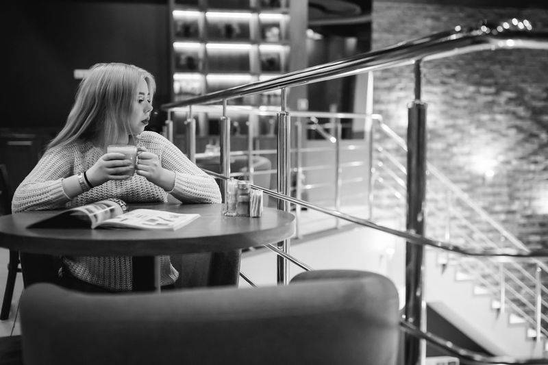 Woman Having Drink In Restaurant