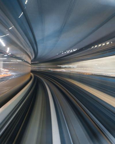 Blurred motion of illuminated railroad tracks