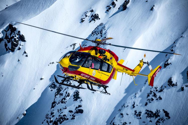 Ski lift on snowcapped mountain