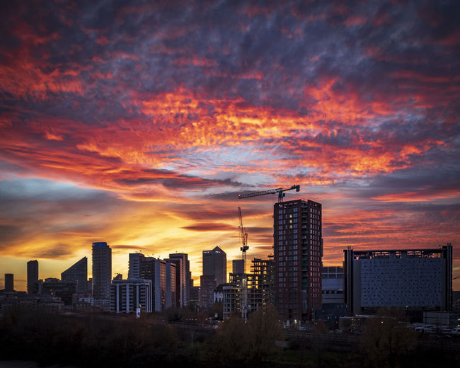 Modern buildings against romantic sky at sunset