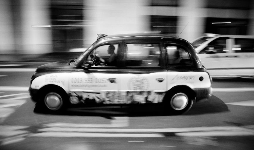 B&w Street Photography Blurred Motion Car City Citystream London On The Move Speed Street Taxi Vehicle Black And White Urban Urbanphotography Monochrome Life In Motion Blackandwhite Black & White Mobility In Mega Cities