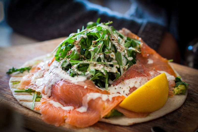 Smoked salmon salad on flatbread