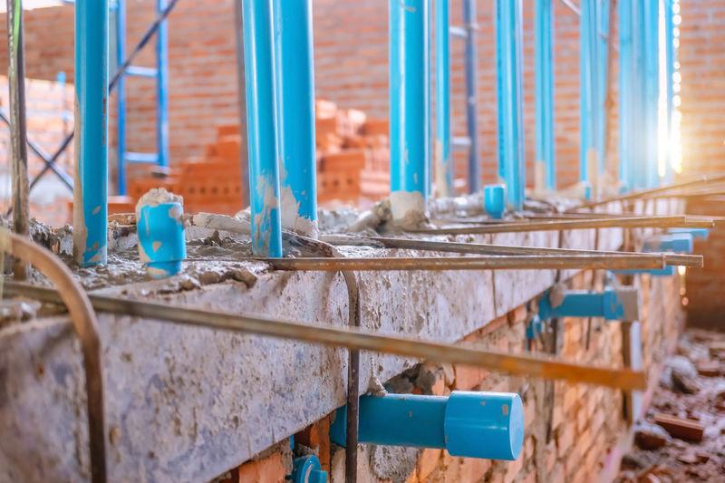 Close-up of metal railing against building