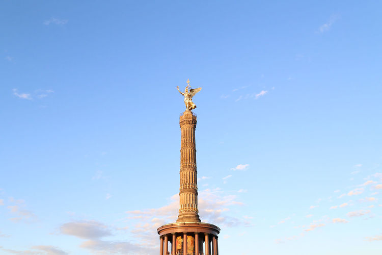 Low angle view of statue on column against sky