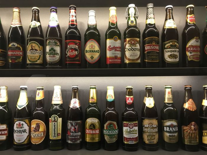 Prague Czech Republic Abundance Alcohol Arrangement Beer Bottles Bottle Choice Collection Communication Container Drink Food And Drink In A Row Indoors  Large Group Of Objects No People Order Retail  Retail Display Shelf Still Life Text Variation