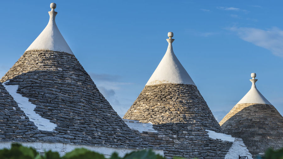 Trulli of the Itria valley. Farmhouses. Details in the sky. Puglia, Italy. Italy Puglia Puglia South Italy Tourism Tourism Destination Trulli Trulli Houses Trulli Puglia Alberobello Alberobello - Puglia Apúlia Apulia Italy Italia Puglia Apulian Landscape Southern Southern Italy Trullo Martina Franca Landmark Landmarkbuildings Landmark Building Landmarks Monument Architecture Architecture And Art Exterior Exterior View Exterior Building Exterior Architecture Itria Itria Valley Tourist Tourist Attraction  Tourist Destination Roof Building Outdoors Outdoor Photography Unesco UNESCO World Heritage Site Architectural Design Architectural Traditional Architectonic Architectonic Detail Construction Historic Symbol Landscape Typical Typical Houses The Minimalist - 2019 EyeEm Awards The Architect - 2019 EyeEm Awards