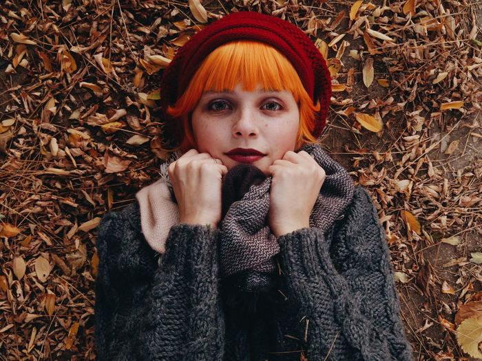 Autumn Change Clothing Front View Hairstyle Headshot Leaf Leisure Activity Lifestyles Looking At Camera One Person Plant Part Portrait Real People Scarf Sweater Teenager Waist Up Warm Clothing Women Young Adult Young Women