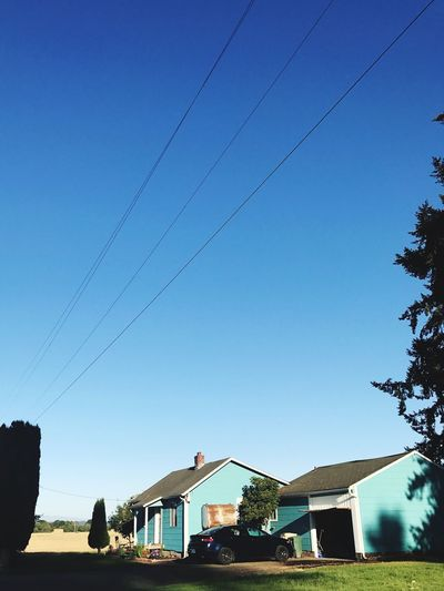That little blue house right on the country side Clear Sky Building Exterior Low Angle View Tree Cable Architecture Nature Sky