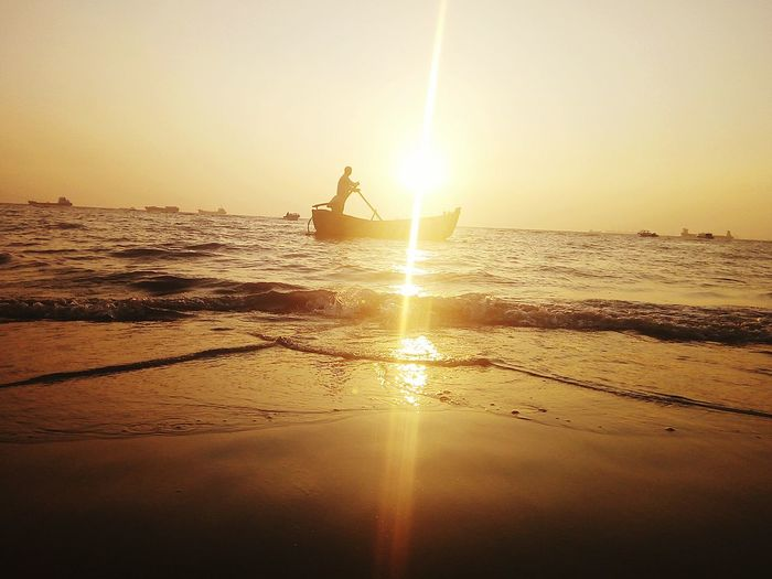 sea,sunset,boat,boatman,sand,refletion of sun , running boat, single man, Sea Sunset Reflection Water Sand Beach Sunlight Sun Horizon Over Water Nature Silhouette Outdoors Beauty In Nature Vacations Refraction Business Finance And Industry Sky Only Men Day People Break The Mold EyeEmNewHere Visual Feast The Great Outdoors - 2017 EyeEm Awards