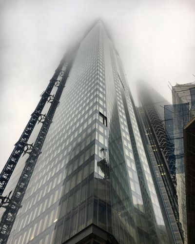 Skyscraper disappearing in the fog Building Exterior Architecture City Built Structure Sky Office Building Exterior Tall - High Skyscraper Building Modern Low Angle View Office Day Nature Tower Fog Cityscape Outdoors