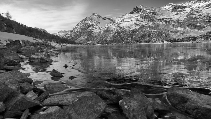 Mountain Lake Landscape Travel Scenics Outdoors Nature Mountain Range No People Cloud - Sky Wilderness Area Snow Sky Day Icedlake Alps Alps Switzerland Alpsee Tranquil Scene Blackandwhite Black And White Black & White Beauty In Nature Reflection Nature
