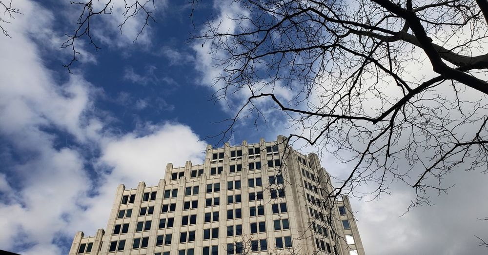 A BUILDING IN BETHESDA Maryland Pixelated City Modern Sky Architecture Building Exterior Cloud - Sky Built Structure Office Building Urban Skyline Tall - High Historic Historic Building Financial District  Cityscape The Street Photographer - 2018 EyeEm Awards