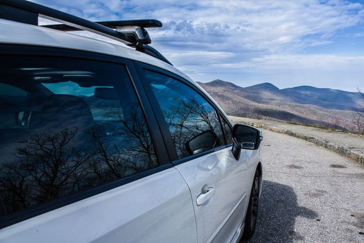 Close-up of car on mountain against sky