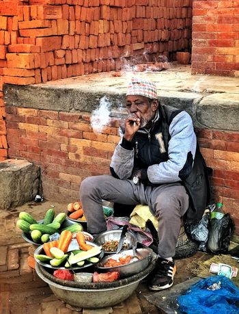 Smoker Hawker Nepal Bhaktapur Street Photography Hawker Food Hawker Smoker One Man Only Only Men One Person Adult Portable Information Device Sitting Adults Only Real People Full Length Market Food Men People Candid