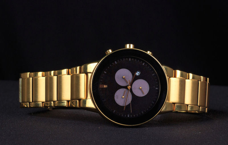 Golden Watch Gold Gold Watch Golden Black Background Circle Clock Clock Face Close-up Copy Space Geometric Shape Golden Watch Illuminated Indoors  Lighting Equipment Nature Night No People Number Personal Accessory Shape Still Life Studio Shot Technology Time Watch