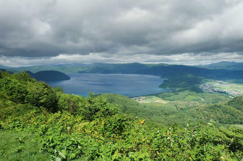 Hokkaido Mt Usu Shikotsu Toya National Park Beauty In Nature Caldera Lake Cloud - Sky Day Environment Green Color Land Landscape Mountain Nature No People Non-urban Scene Outdoors Overcast Plant Scenics - Nature Sea Sky Tranquil Scene Tranquility Volcanic Landscape Volcano Water