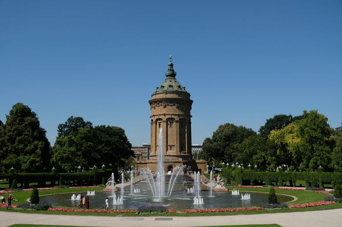 Mannheim, Germany - August 23, 2017: Mannheimer Wasserturm, a 60m sandstone water tower and city square landmark dating from 1889 decorated in sculptures Exterior Landmarks Mannheim Mannheim Germany Wasserturm Wasserturm Mannheim  Water Tower Architecture Building Building Exterior Buildings Built Structure Clear Sky Day Fountain History Landmark Monument Outdoors Sculpture Sky Statue Tower Tree Water