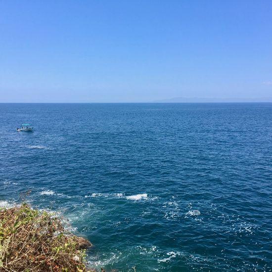 Single boat Single Boat! Single Boat Blue Sea Single Boat Blue Sea And Blue Sky