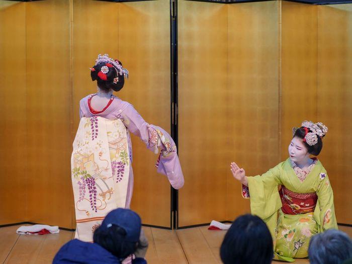 "Kyo-mai dance ""Gion kouta"" 京舞 祇園小唄 11, April 2018 / Maiko ""Mizuno ( wisteria long draping sash ) "" and Maiko ""Yuriha"" on Stage. Yasaka Club, Gion Kyoto in Japan Travel Destinations Stage Photography Kimono Girl Panasonic GX8 LEICA DG NOCTICRON 42.5mm/F1.2 ASPH 85mm No Flash 祇園甲部 舞妓 Kyo-mai ( 京舞 ) Stage - Performance Space Real People Traditional Clothing Headwear Indoors"