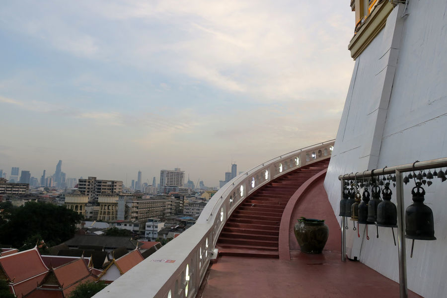 view on stair up to golden mountain pagoda High Pagoda Stairway Architecture Building Exterior City Cityscape Day Evening Modern Mountain No People Outdoors Sky Stair Stairways Temple - Building Viewpoint