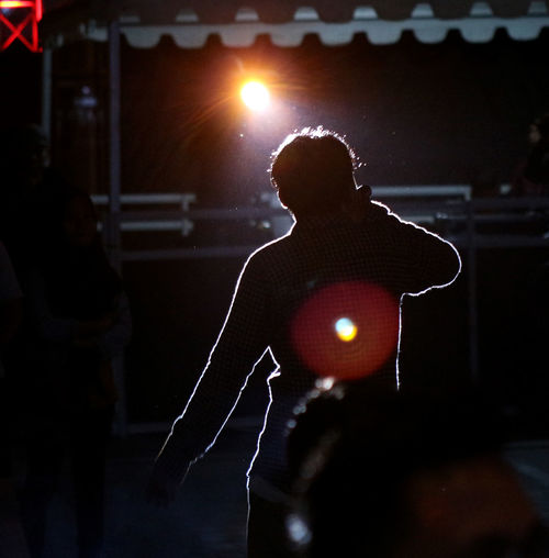 men under the light Arts Culture And Entertainment Illuminated Incidental People Indoors  Light Lighting Equipment Men Music One Person Performance Real People Rear View Silhouette Stage Stage - Performance Space Stage Light