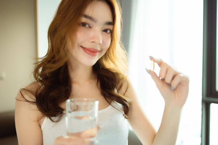 Portrait of beautiful woman drinking glass