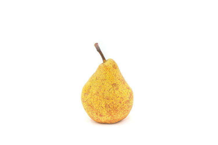 Pear White Background Studio Shot Food And Drink Food Indoors  Cut Out Yellow Close-up Freshness Still Life No People Healthy Eating Copy Space Single Object Wellbeing Fruit High Angle View Sweet Food Pear Spice Temptation